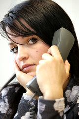 Young Woman Using Telephone. Model Released