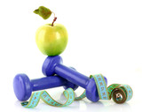 Dumbbells, green apple and measuring tape  isolaeted on white