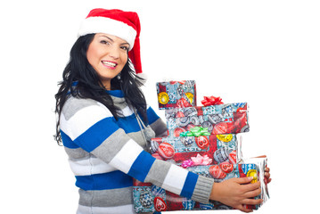 Smiling Santa helper holding several  gifts