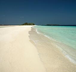 Long sandbar of white sand