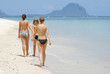 Three topless girls at the beach