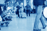 Blurred advancing people through airport installations poster