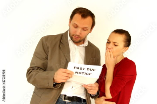 Young couple receives past due notice, isolated