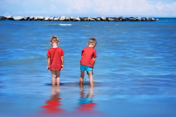 Brothers playing in the Adriatic Sea.