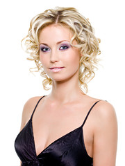Beautiful young blond woman with curly hairstyle