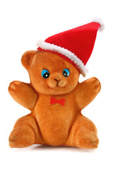 toy bear in the hat of santa claus