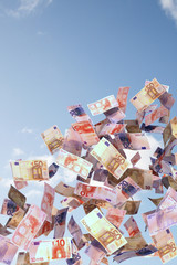 euro bills in the sky