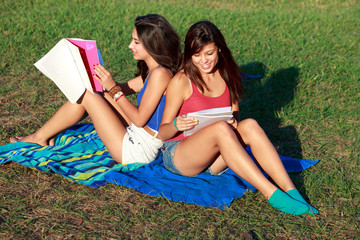 Teenage college students studying outdoor in university campus
