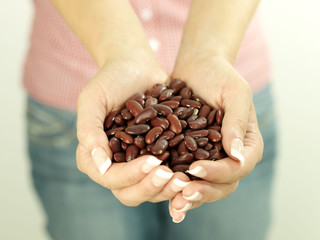 Young Woman With Handful of Kidney Beans. Model Released