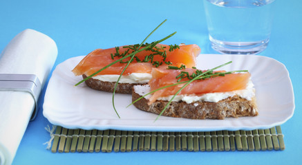 Smoked salmon on creamed cheese with chives