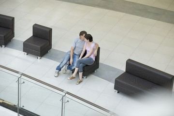 Young couple sit together in new shopping mall, Voronezh