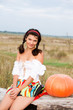 Beautiful woman with pumpkin.