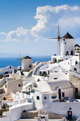 Traditional windmills in village Oia Cyclades island Santorini