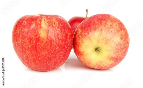 Three red apples isolated.