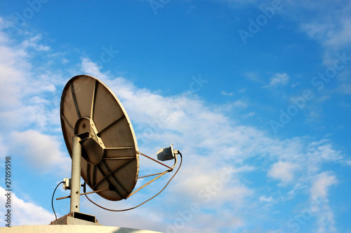 Satellite dish on blue sky