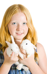 girl with pet rabbits