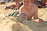 young girl and boy at the beach with wet hair - Fine Art prints