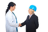 Doctor and architect women shaking hands