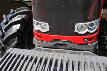 tractor in front close-up with headlights and tyre 3