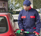 Gas Station Worker Refilling Car at Service Station