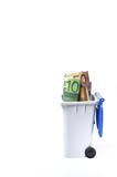Dinero a la  basura