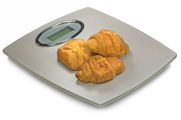 Grey Digital Bathroom Scale And Croissants, Isolated