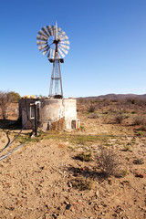 Moving windpump next to dam in Karoo