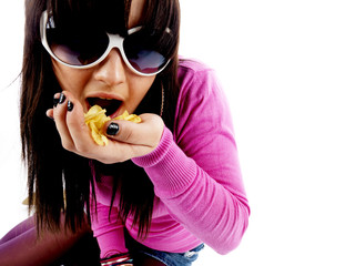 Teenage Girl Eating Crisps. Model Released
