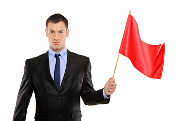 Portrait of a young man holding a red flag