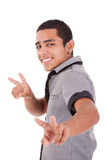 Young latin man with thumbs raised as a sign of victory