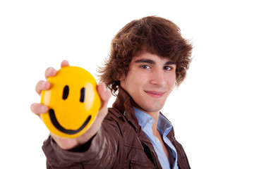 man with a yellow smile face on hand