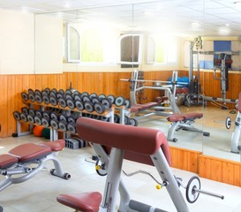 Gym interior bodybuliding weights exercise room