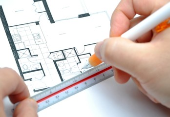 House floor plan on grid paper with ruler.