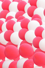 cloud of beautiful pink and white balloons