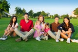 family friends group people sitting green grass