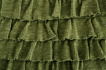 pleated skirt fabric fashion in green closeup
