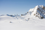 Alps mountains in winter and ski slopes poster