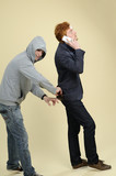 teen stealing wallet and business man calling poster