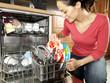 Woman Emptying / Filling Dishwasher. Model Released
