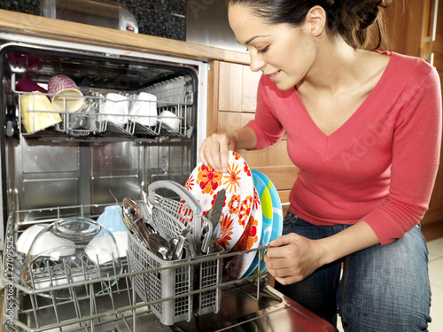 Woman Emptying / Filling Dishwasher. Model Released