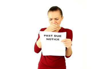 Young woman receives past due notice, isolated