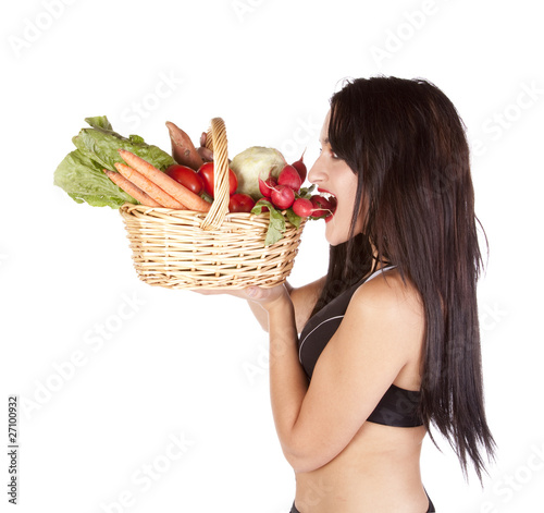 Woman vegetables bite