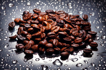 Coffee beans , water drops background
