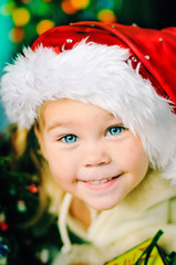 portrait of little happy Christmas girl in santa's hat