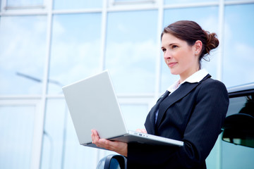 business woman outside with notebook