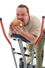 Man eating huge hamburger on a trainer device