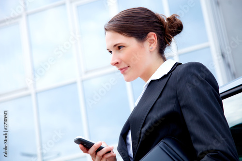 young business woman outside with mobile phone