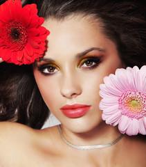 Beauty brunette with flower