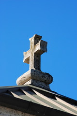 Stone Cross against the blue sky