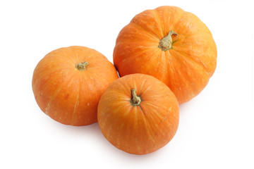 Three pumpkins isolated on white background